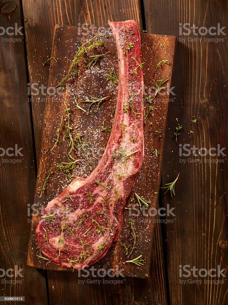 Raw Tomahawk Steak stock photo