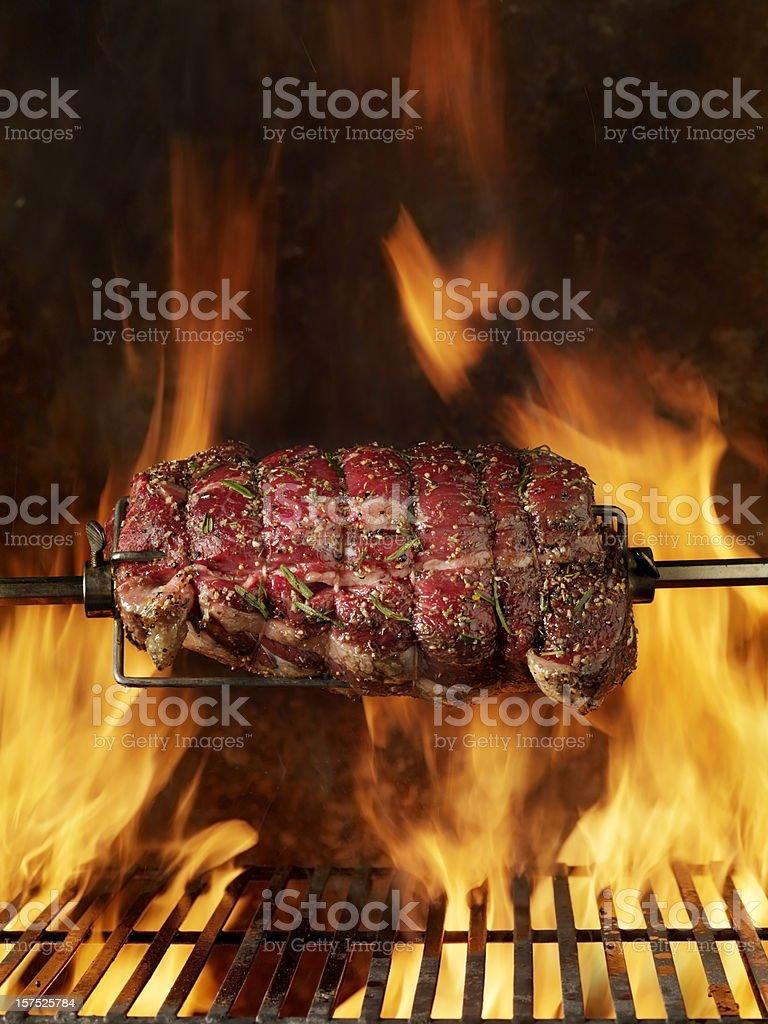 Raw Top Sirloin Beef Roast on the BBQ stock photo
