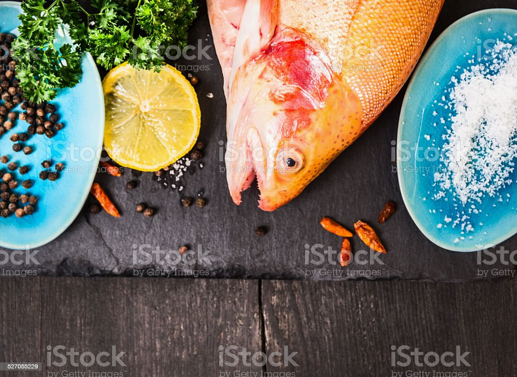 raw  trout with salt,herb and spacy in blue plates stock photo