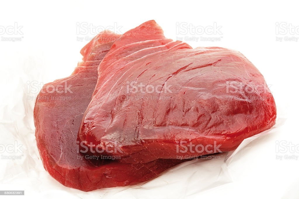 Raw tuna steaks, close-up stock photo