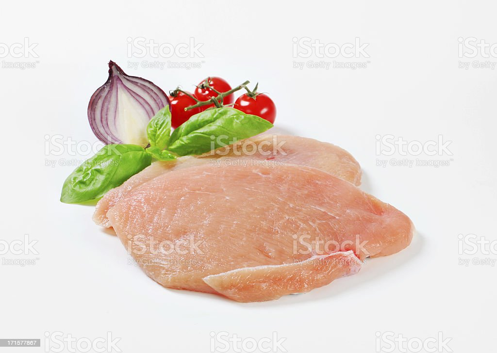 Raw turkey breast steaks royalty-free stock photo
