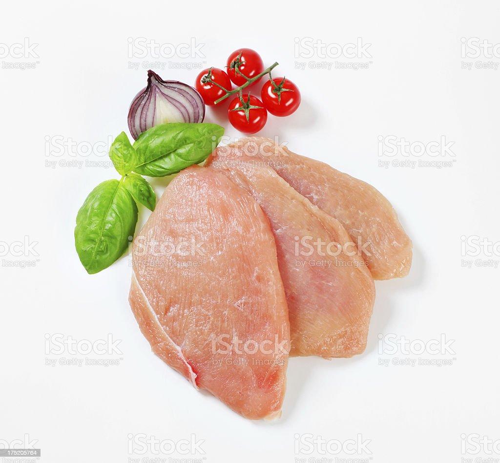 Raw turkey breast steaks royalty-free stock photo