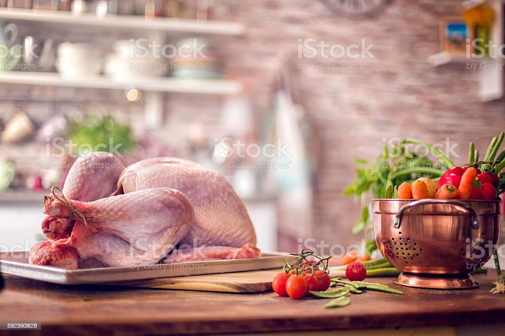 Raw Turkey with Vegetables Ready to be Prepared for Holidays stock photo
