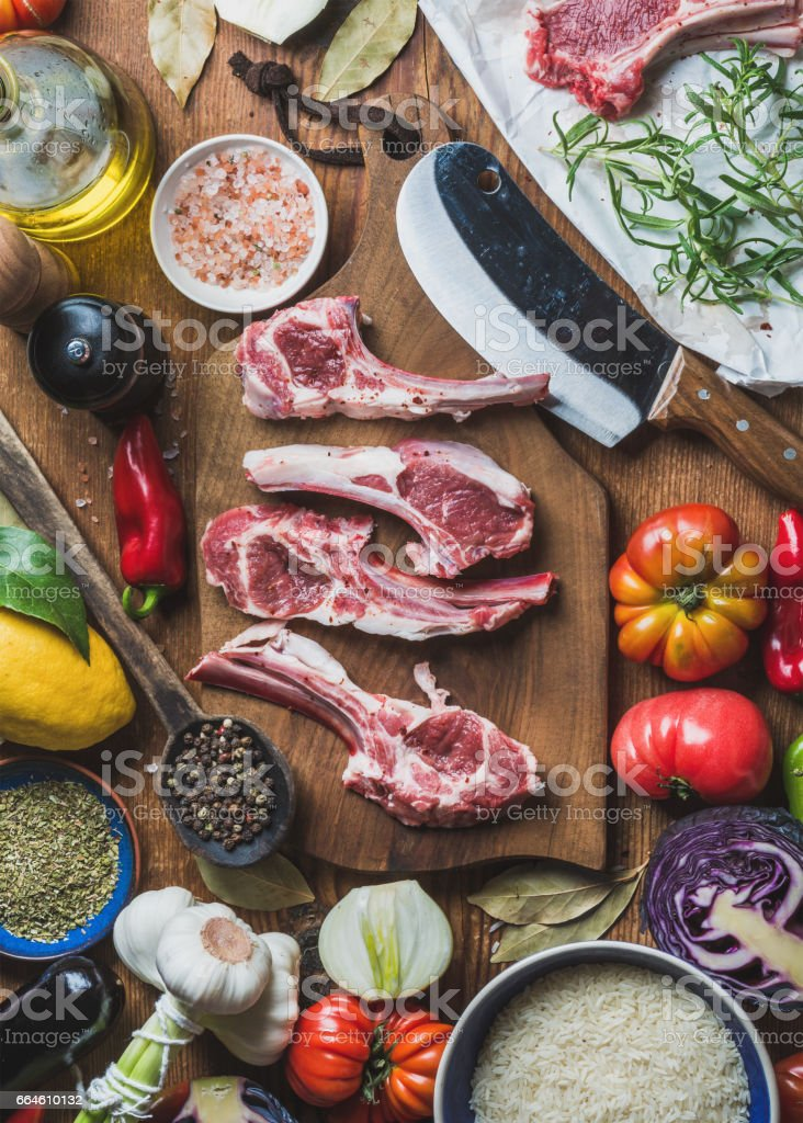 Raw uncooked lamb meat ribs, rice, oil, spices and vegetables stock photo