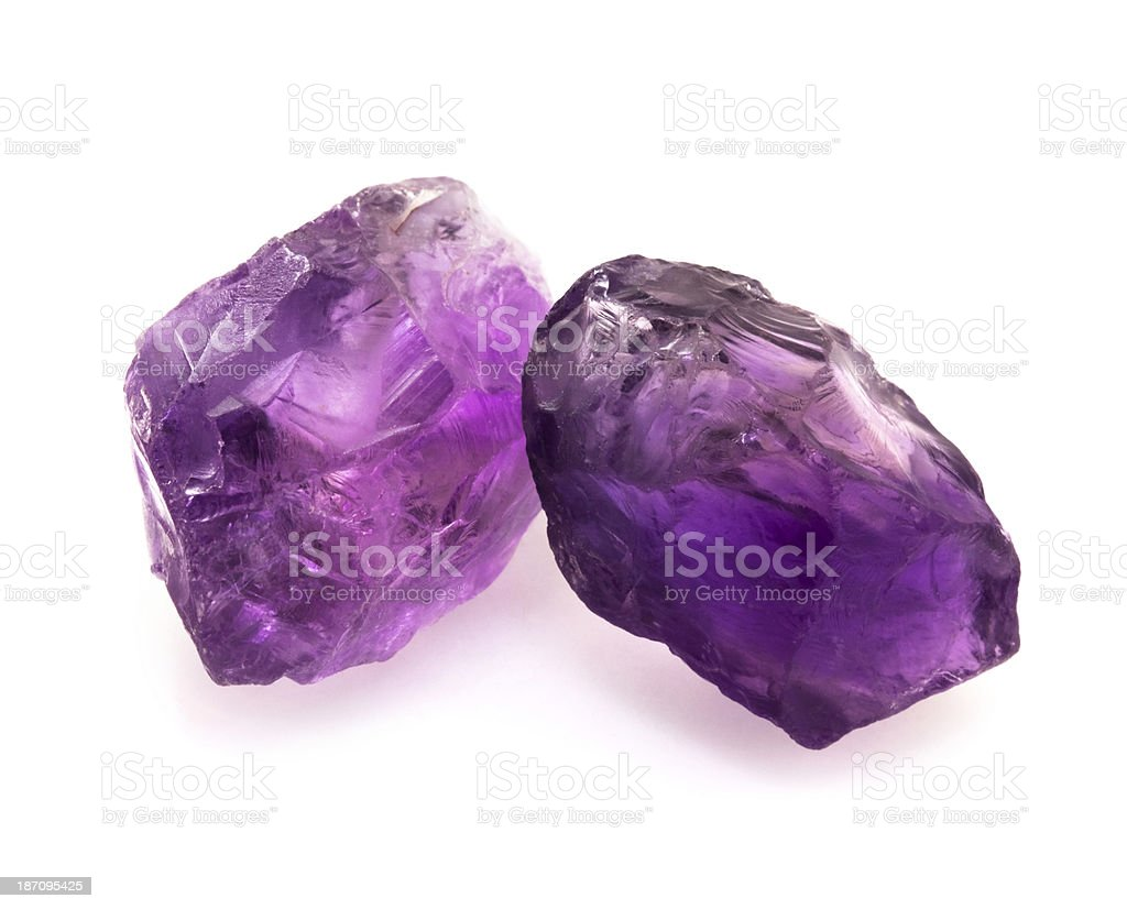 Raw unpolished brazilian amethyst rocks isolated on white background. stock photo