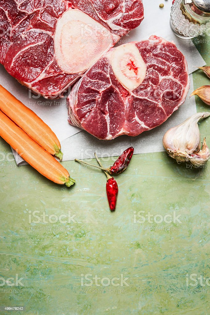 Raw veal shank meat and ingredients for Osso Buco cooking stock photo