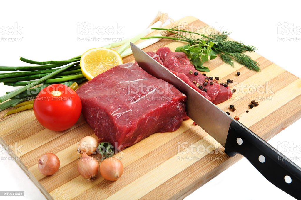 Raw veal with vegetables stock photo