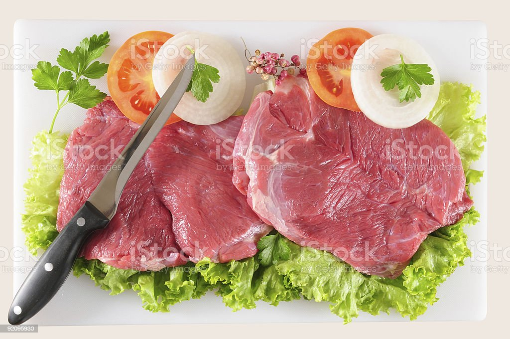 Raw veal with vegetables. royalty-free stock photo