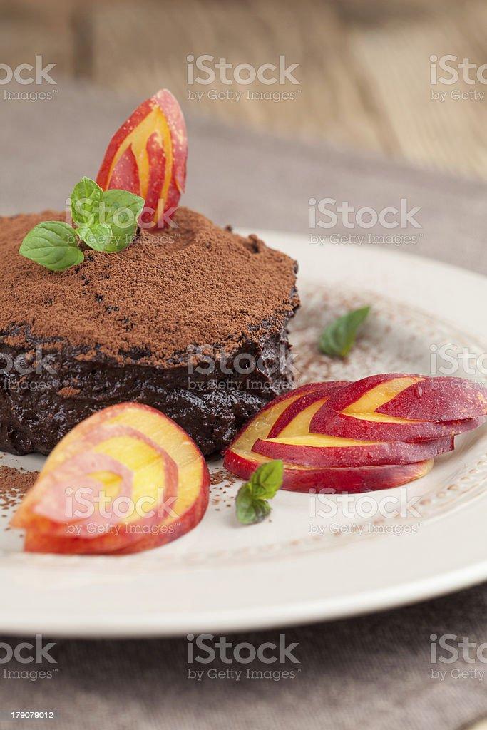 Raw vegan avocado chocolate mousse with nectarine royalty-free stock photo