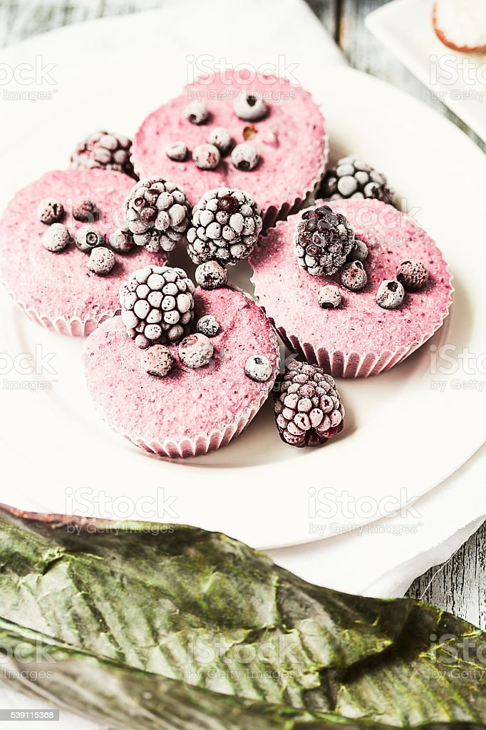 raw vegan berry cheesecake with coconut, close-up stock photo