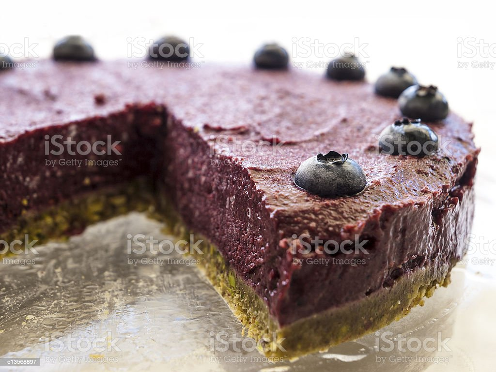 Raw vegan blueberry pistachio cake stock photo