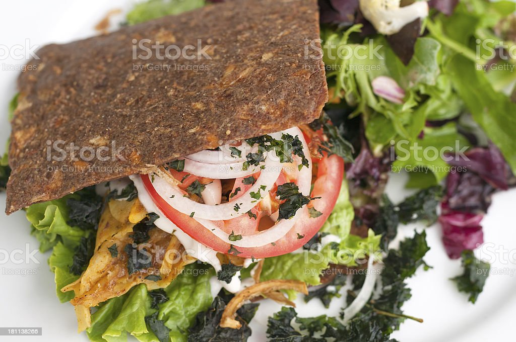 Raw Vegan Burger and Kale Chips royalty-free stock photo