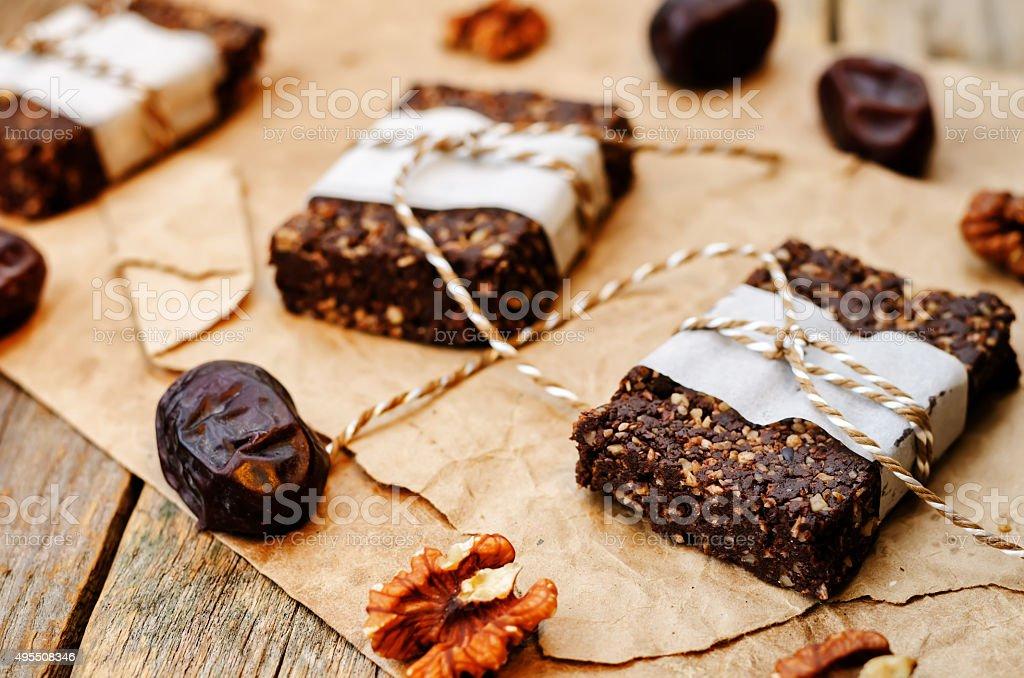 raw vegan dates coconut walnut chocolate bars stock photo