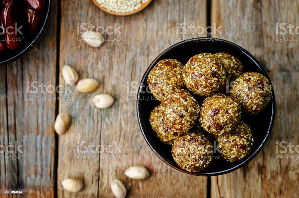 raw vegan dates sesame pistachio balls stock photo