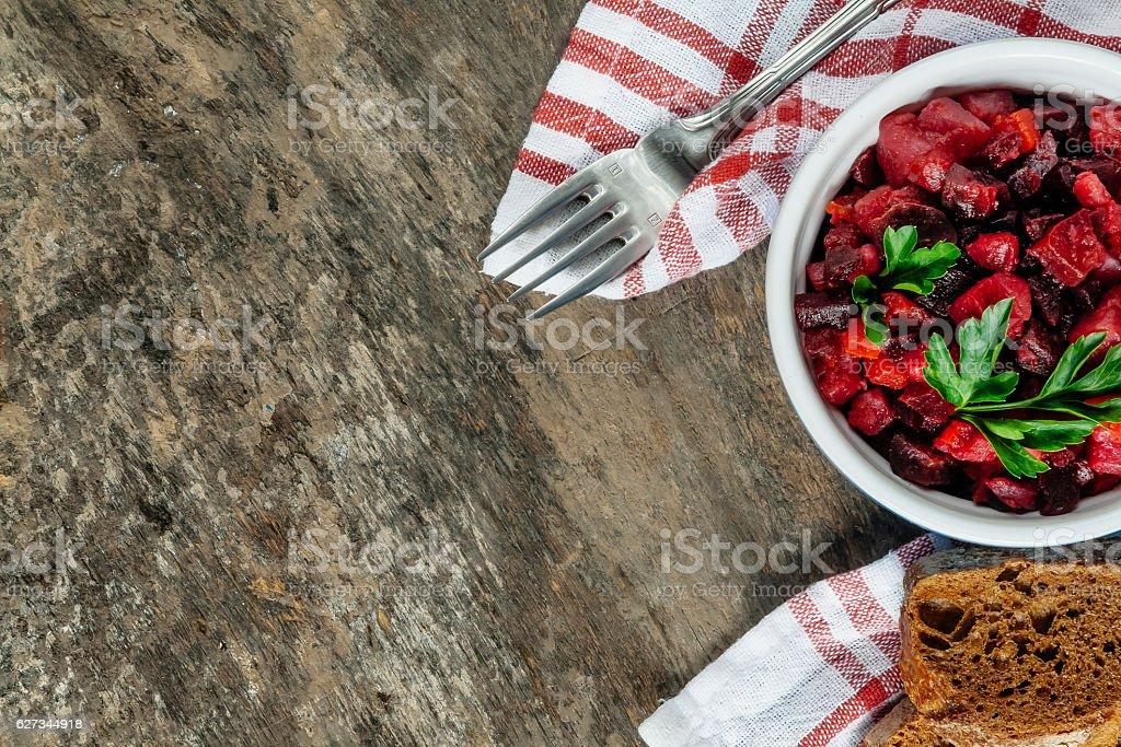 raw vegetables and fresh salad vinaigrette on a rustic backgroun stock photo