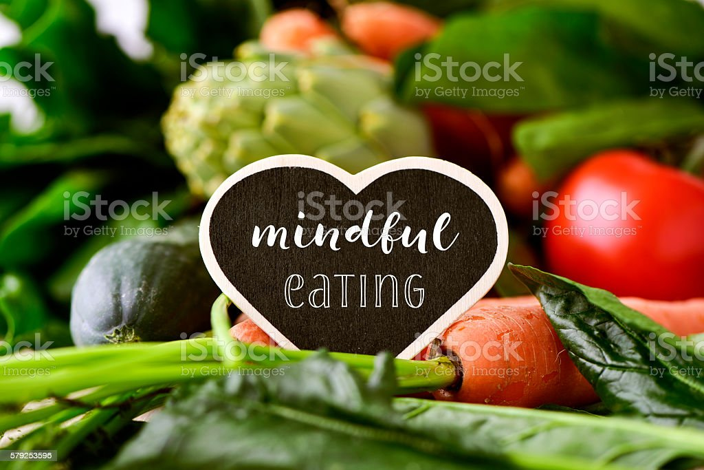 raw vegetables and text mindful eating stock photo
