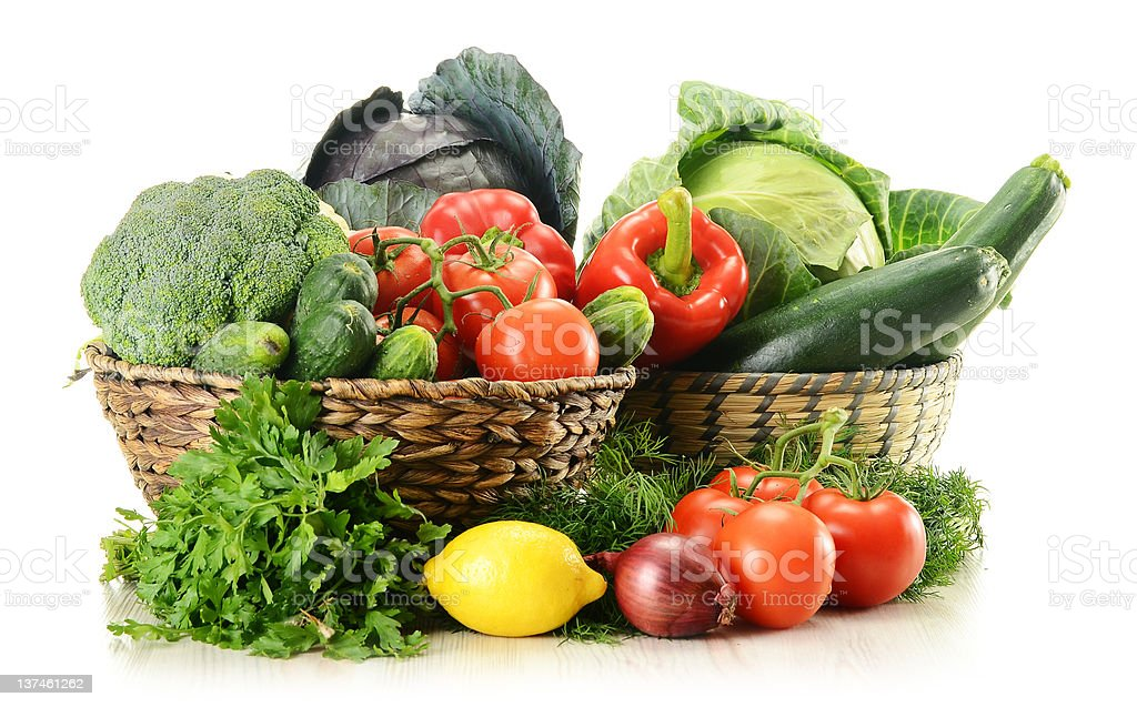 Raw vegetables and wicker baskets isolated on white royalty-free stock photo