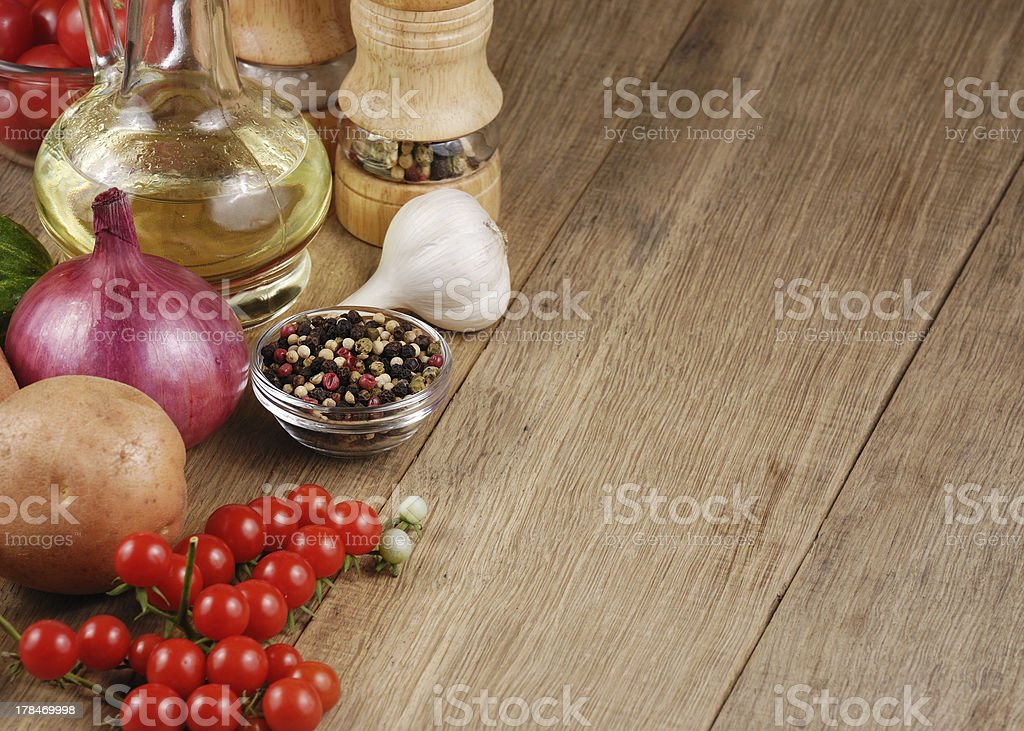 Raw vegetables olive oil and spices royalty-free stock photo