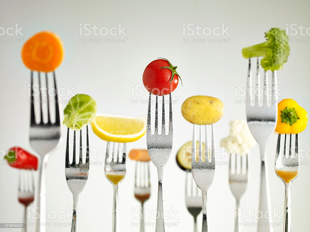 Raw vegetables On Forks royalty-free stock photo