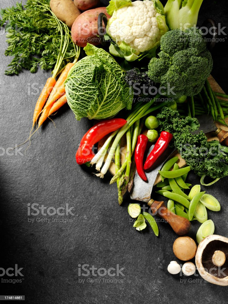 Raw Vegetables on Slate stock photo