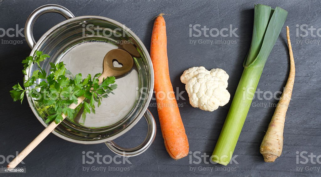 Raw vegetables pot and spoon love cooking concept stock photo