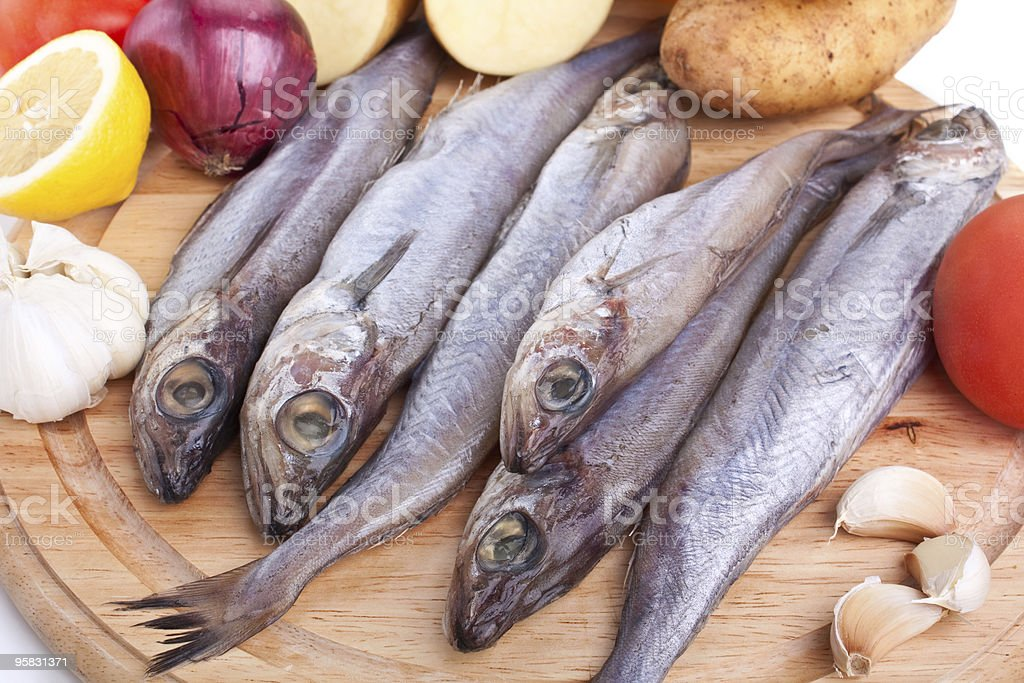 raw whiting fish with vegetables stock photo