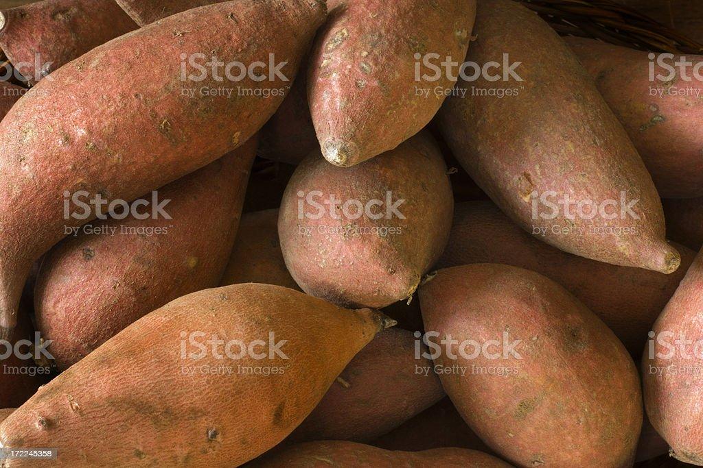 Raw  Whole Sweet Potatoes Yams, Fresh Healthy Root Vegetable royalty-free stock photo