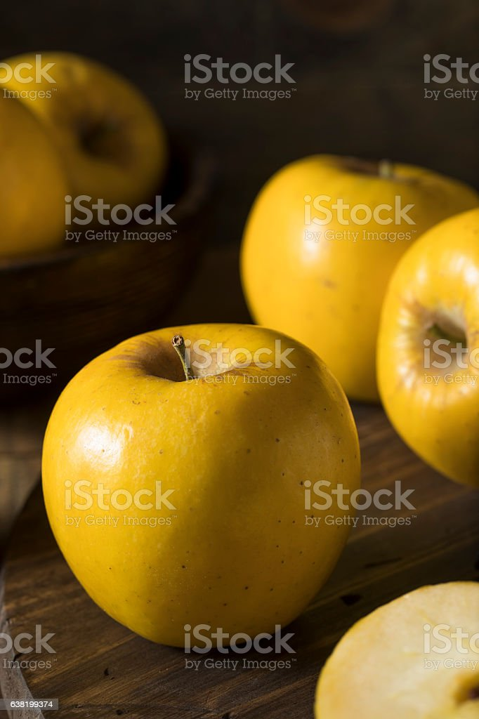 Raw Yellow Organic Opal Apples stock photo