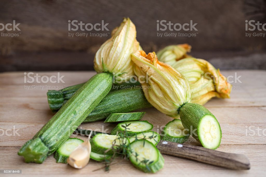 raw zucchini with flowers stock photo