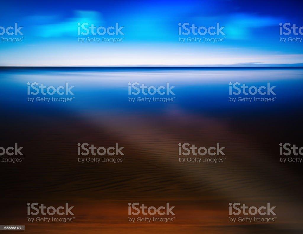 Ray of light at smooth mountain lake stock photo