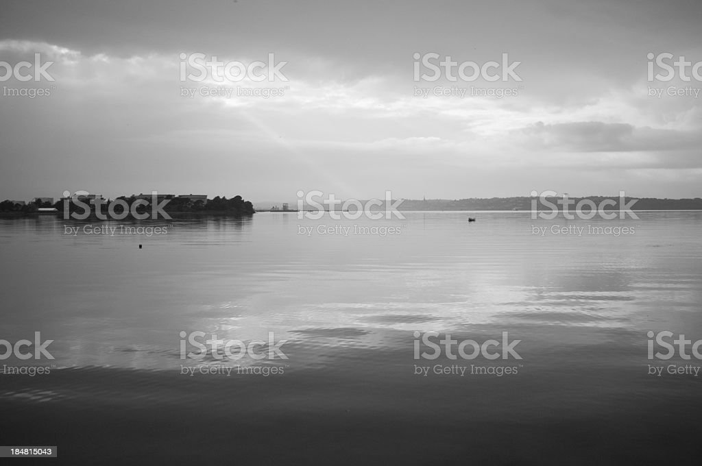 Ray of Light shines down on a small boat stock photo
