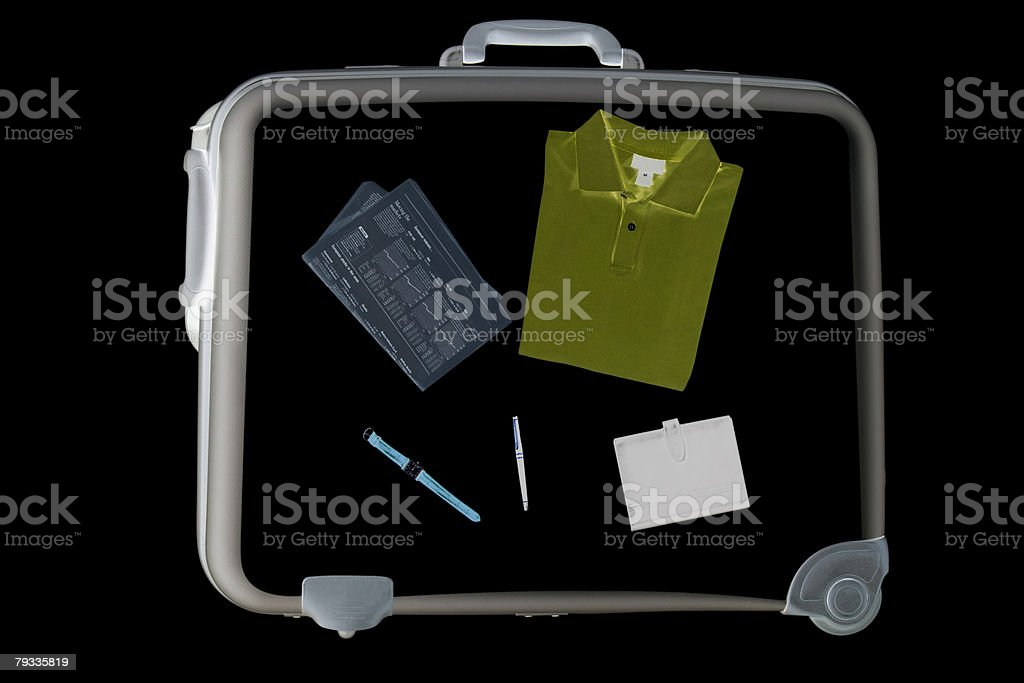X ray of objects in suitcase stock photo
