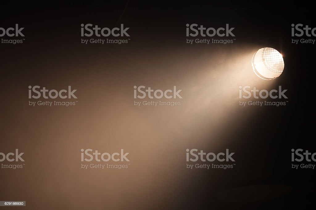 Ray of scenic spot light over dark stock photo