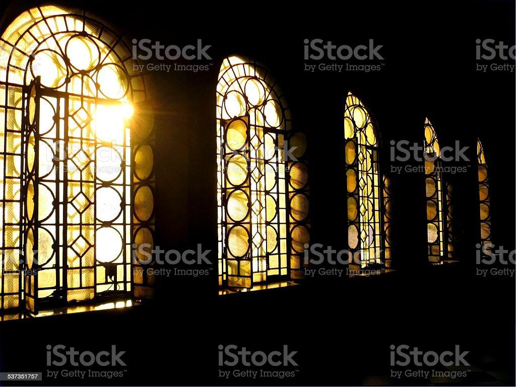 Ray of sun in church corridor stock photo
