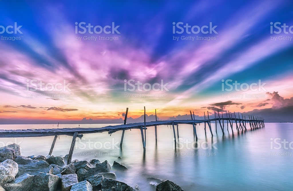 Ray sunrise on a wooden bridge stock photo