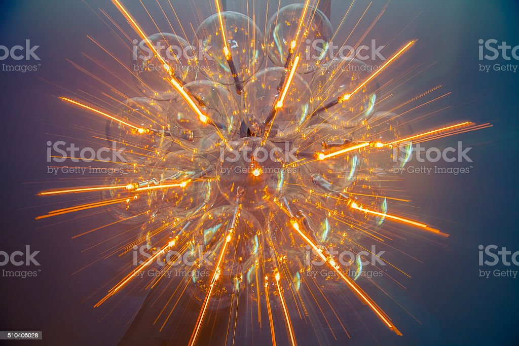 Rays of light from chandelier. Real photo stock photo