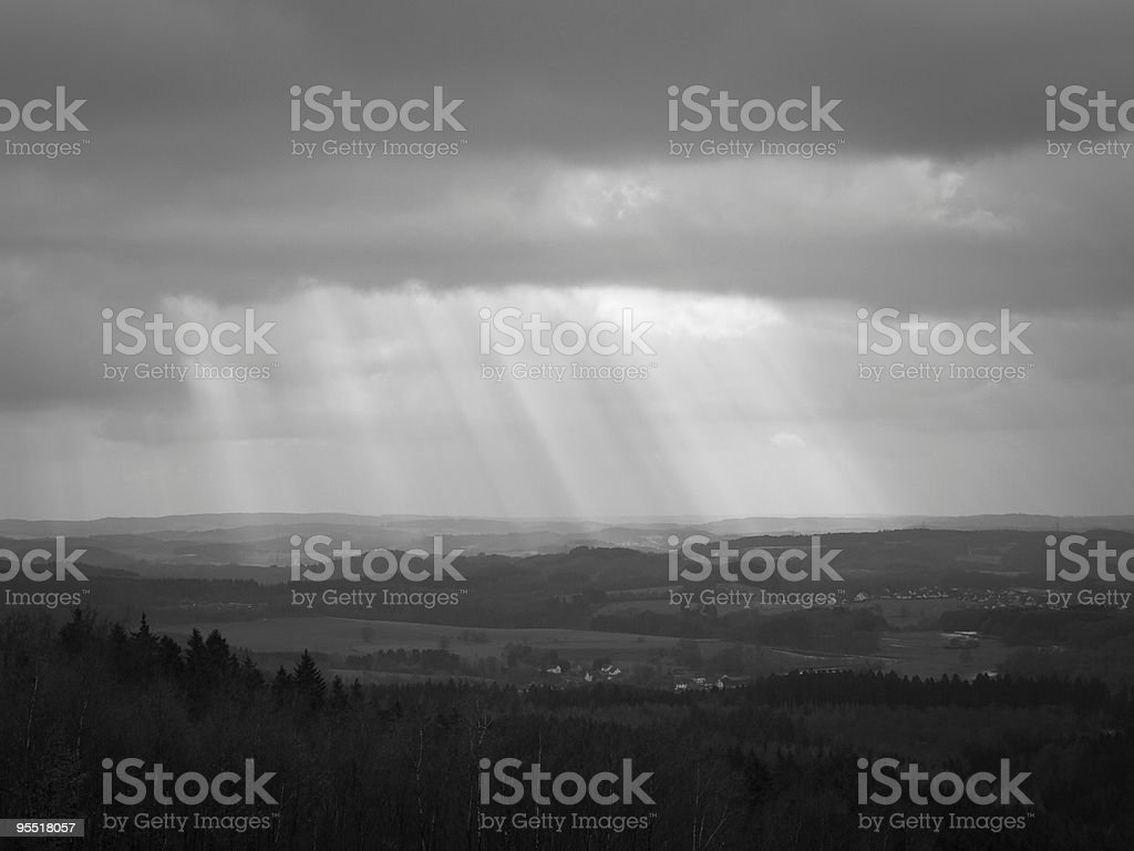 Rays of light on hilly landscape stock photo