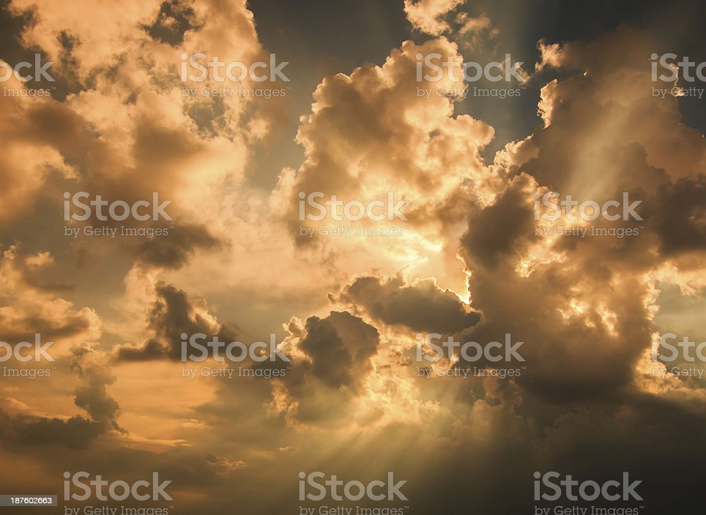 Rays of light shining through dark clouds for background royalty-free stock photo