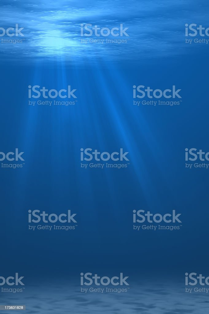 Rays of light shining through the water's surface stock photo