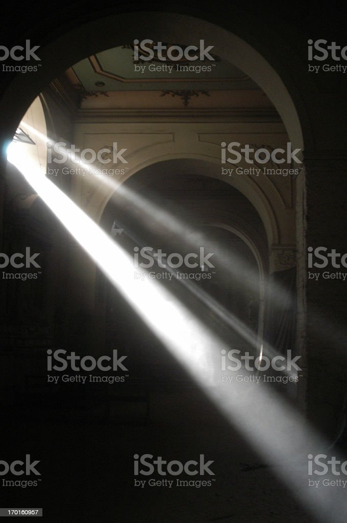 Rays of Light Stream down through Church Window royalty-free stock photo