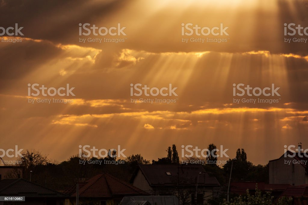 Rays of lights at sunrise with beautiful clouds. stock photo