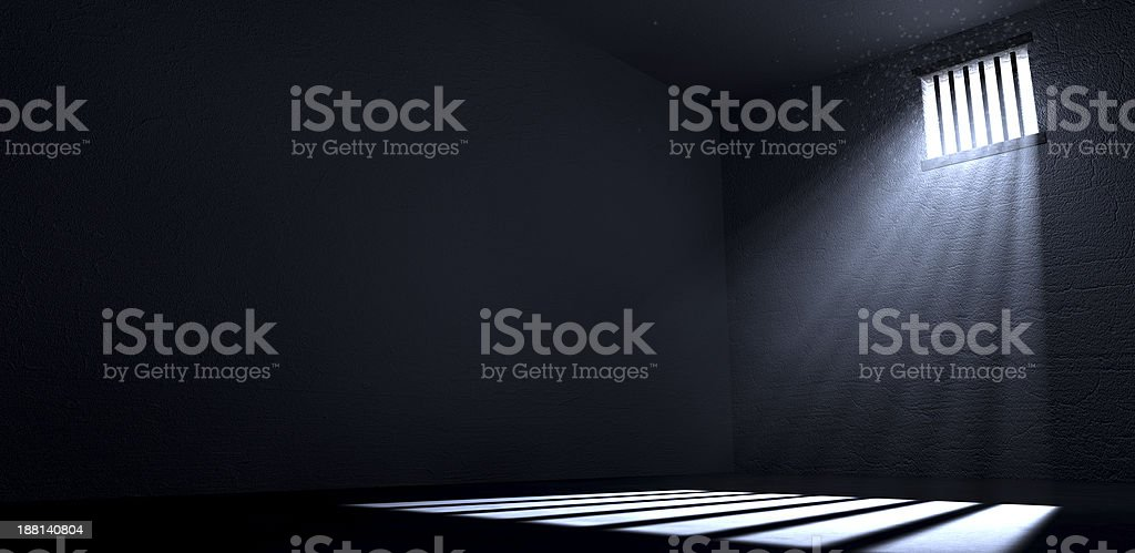 Rays of sun shining through the window of a prison cell stock photo
