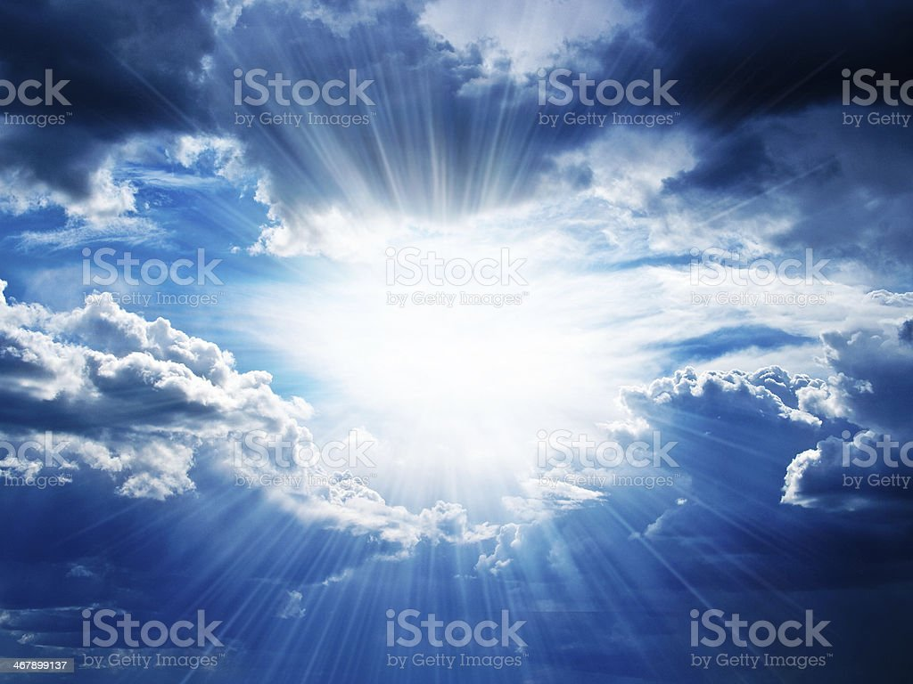 Rays of sunshine breaks through the clouds stock photo