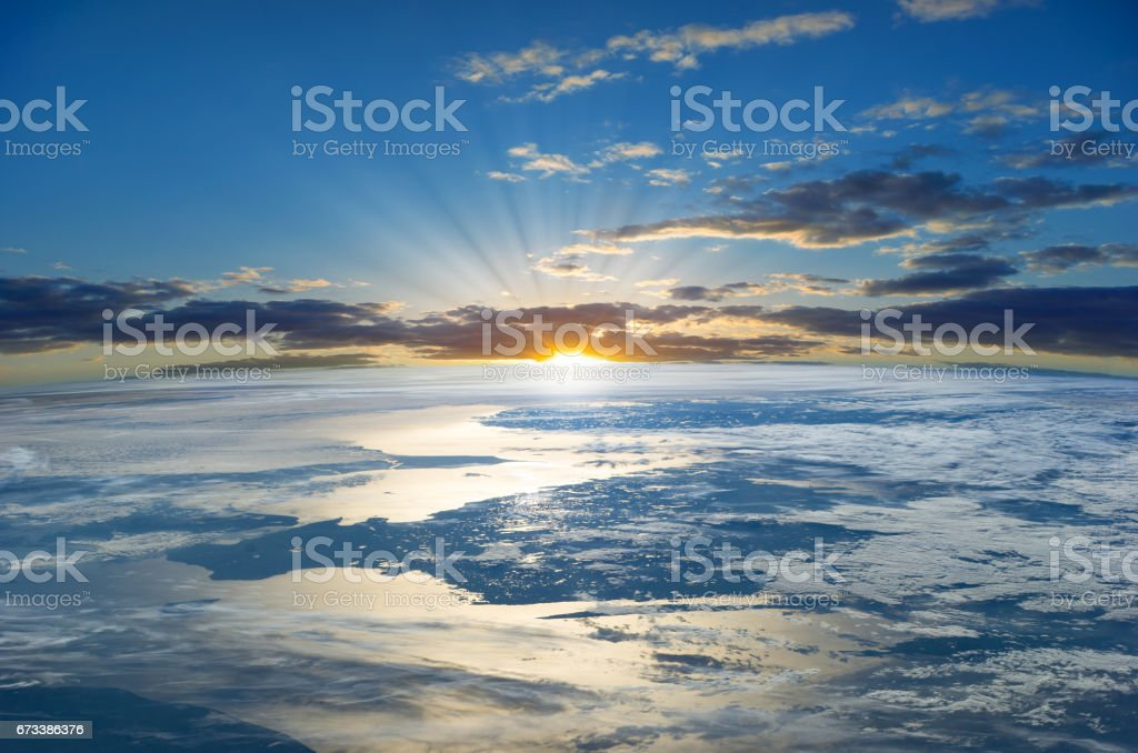 Rays of the Rising Sun over the Planet Earth.  Elements of this image furnished by NASA stock photo