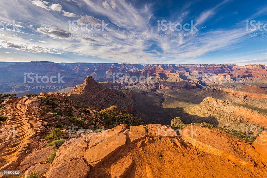 Rays of the sun at sunset illuminate canyon cliff stock photo