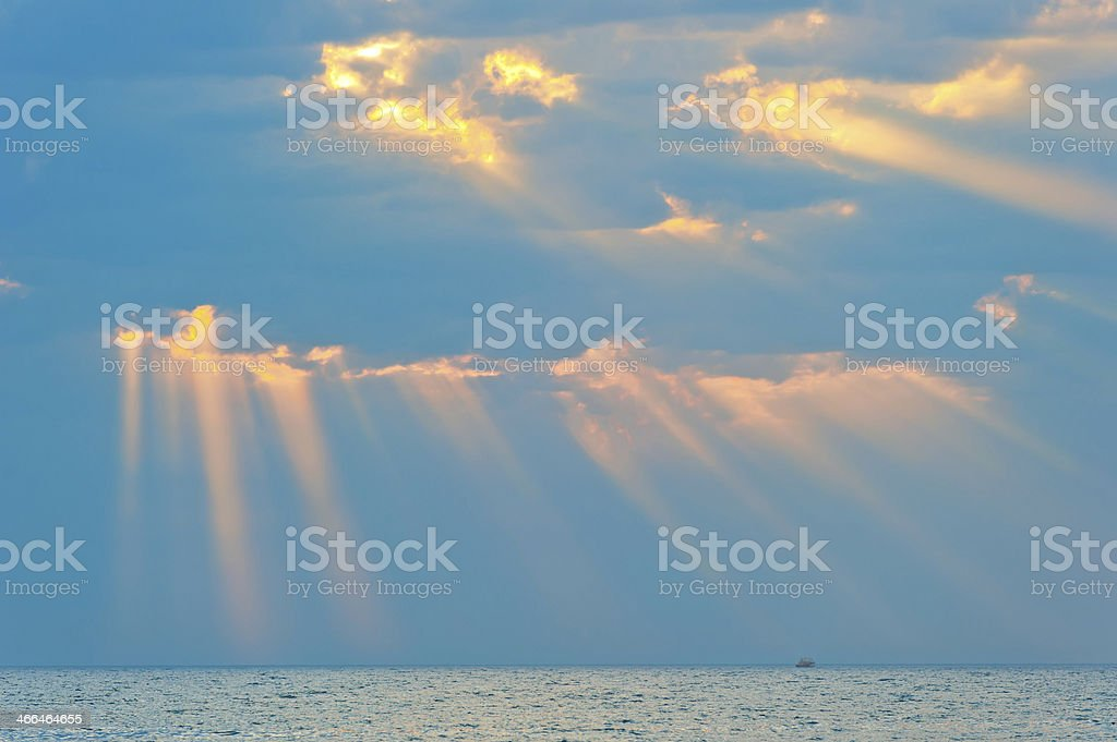 rays of the sun breaking through  clouds royalty-free stock photo