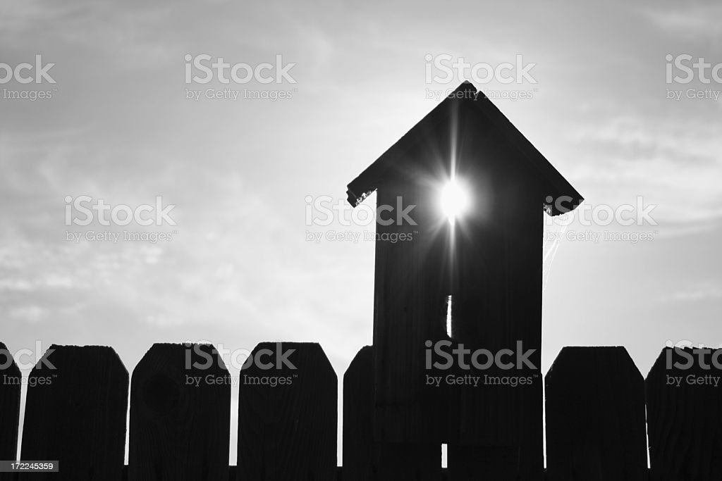 Rays Through a Birdhouse stock photo