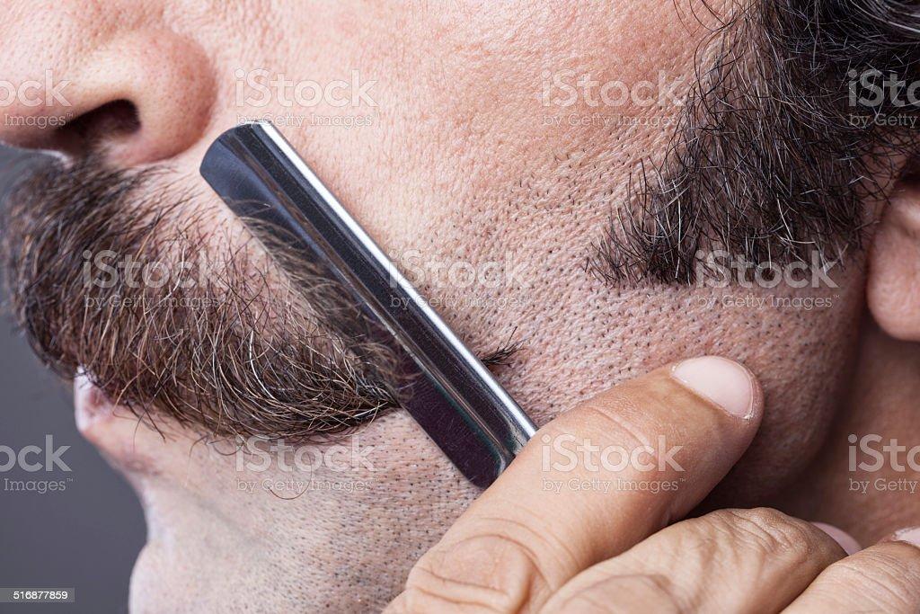 Razor blade on handle bar mustache, close up stock photo