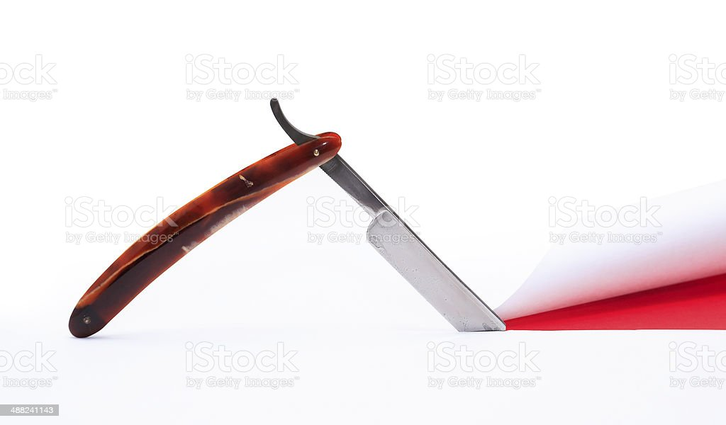 Razor Cutting Paper stock photo