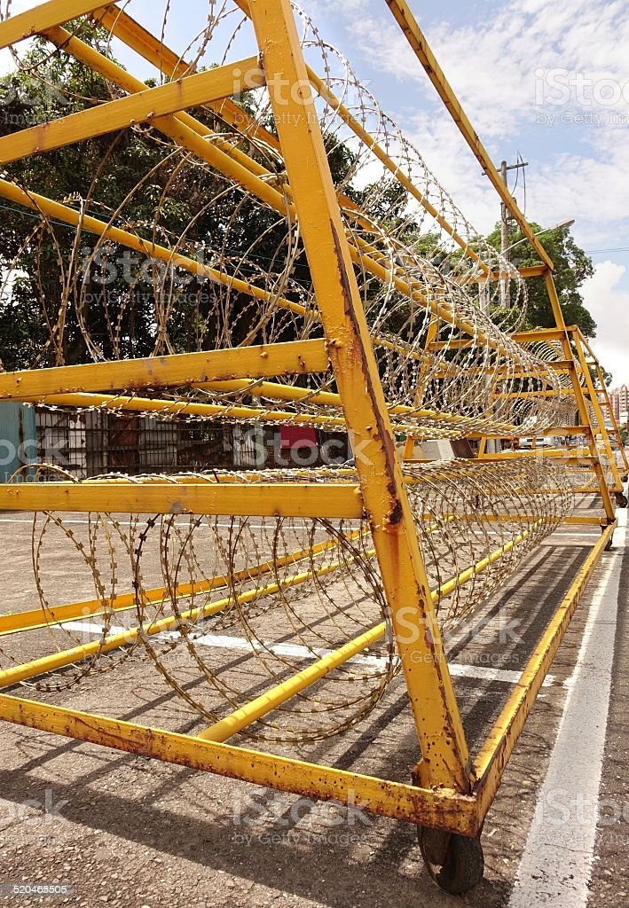 Razor Wire Iron Barrier stock photo